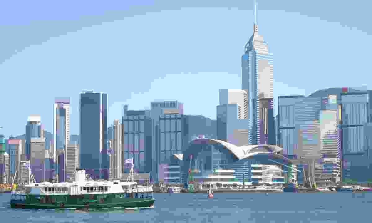 A Shinning Star Ferry crossing Victoria Harbour (Dreamstime)