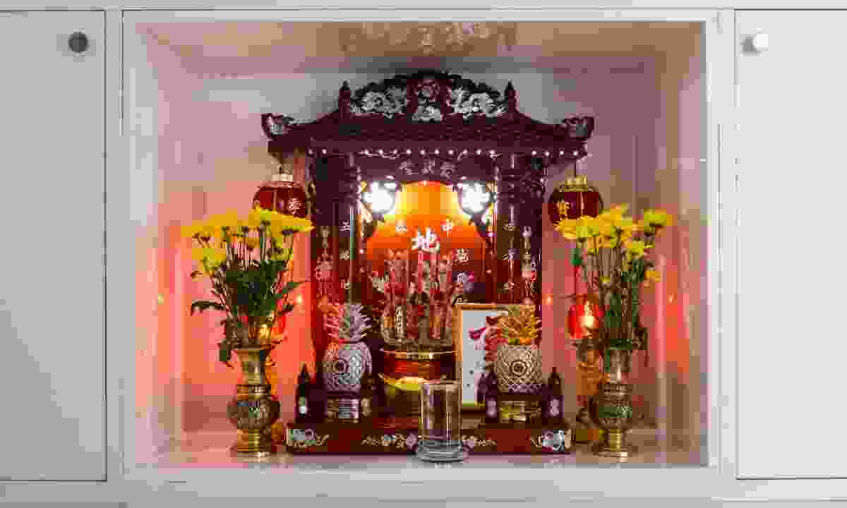 Chinese household shrine, set in a cupboard (Dreamstime)