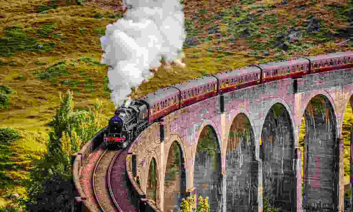 Steam train crossing the Glenfinnan Railway Viaduct (Dreamstime)