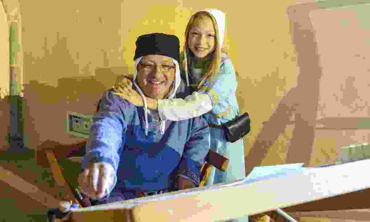 Father and daughter in traditional clothes in the Ardenne (Dreamstime)