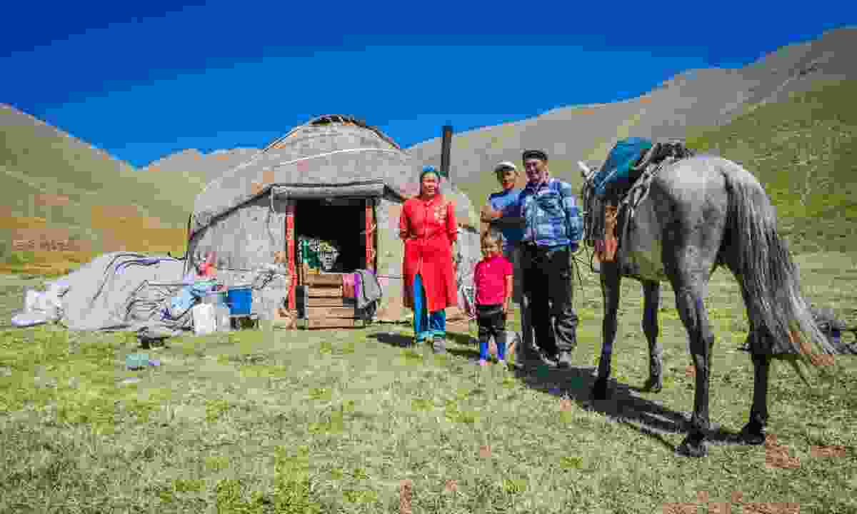 Nomads with their horse on field in Ala Archa, Kyrgyzstan