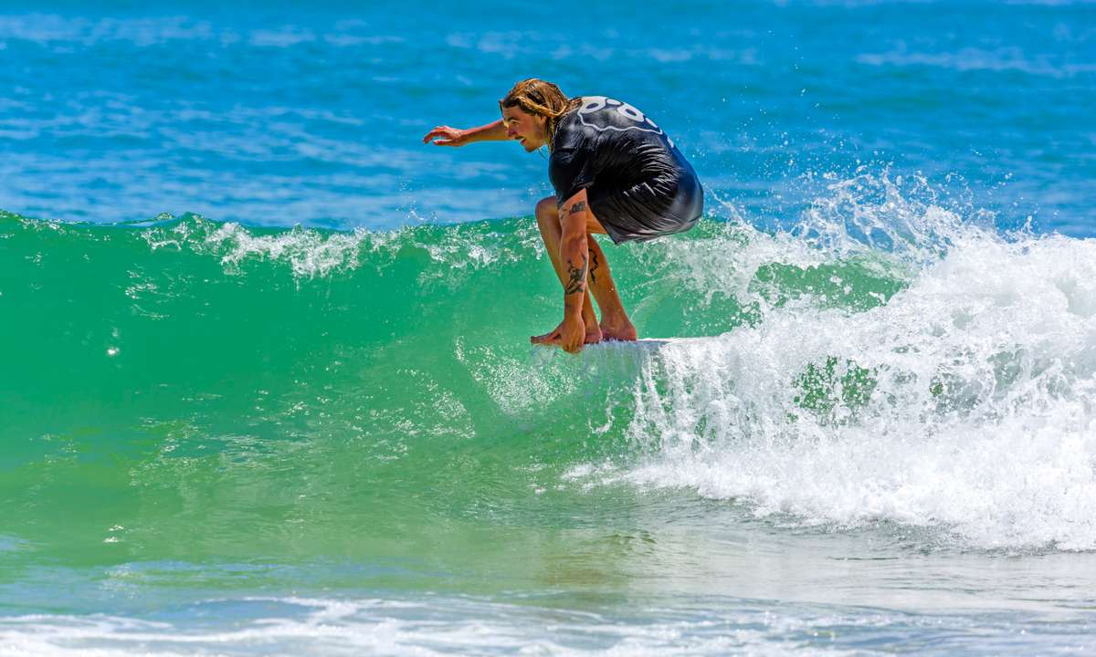 A local catching a wave in Noosa  (Tourism and Events Queensland)