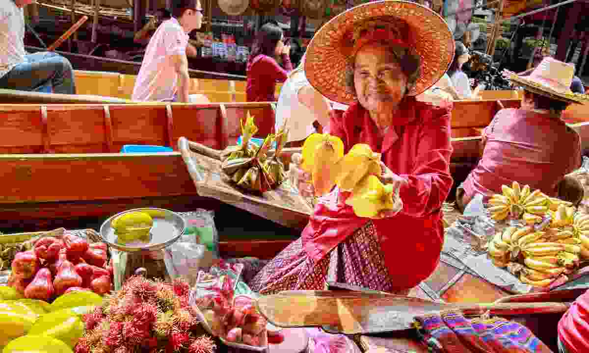 A fruit seller at Damnoen Saduak Floating Market (Shutterstock)