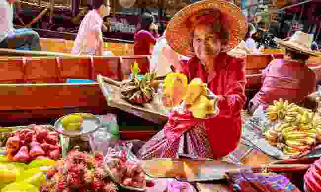 A fruit seller at Damnoen Saduak Floating Market (Shutterstock)