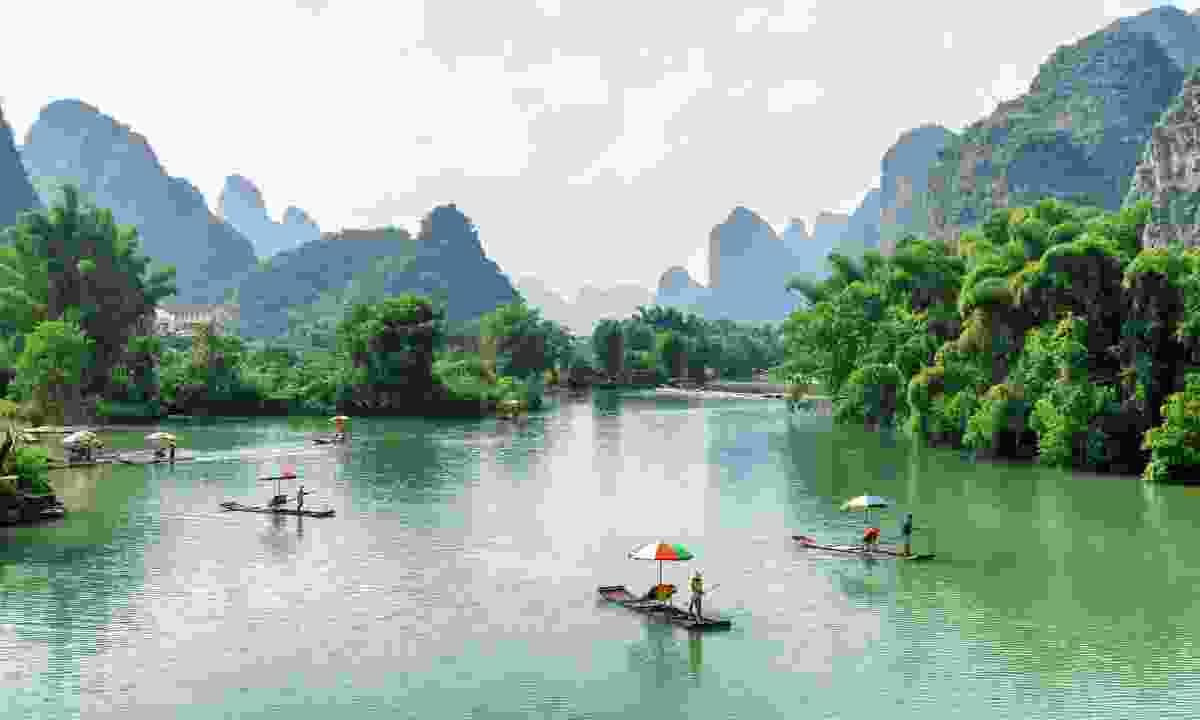 Riding a bamboo raft on the Yulong River in Yangshuo (Shutterstock)