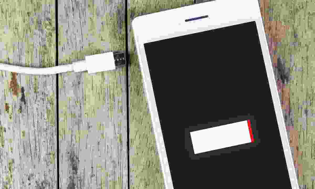 Smart phone and charger (Dreamstime)
