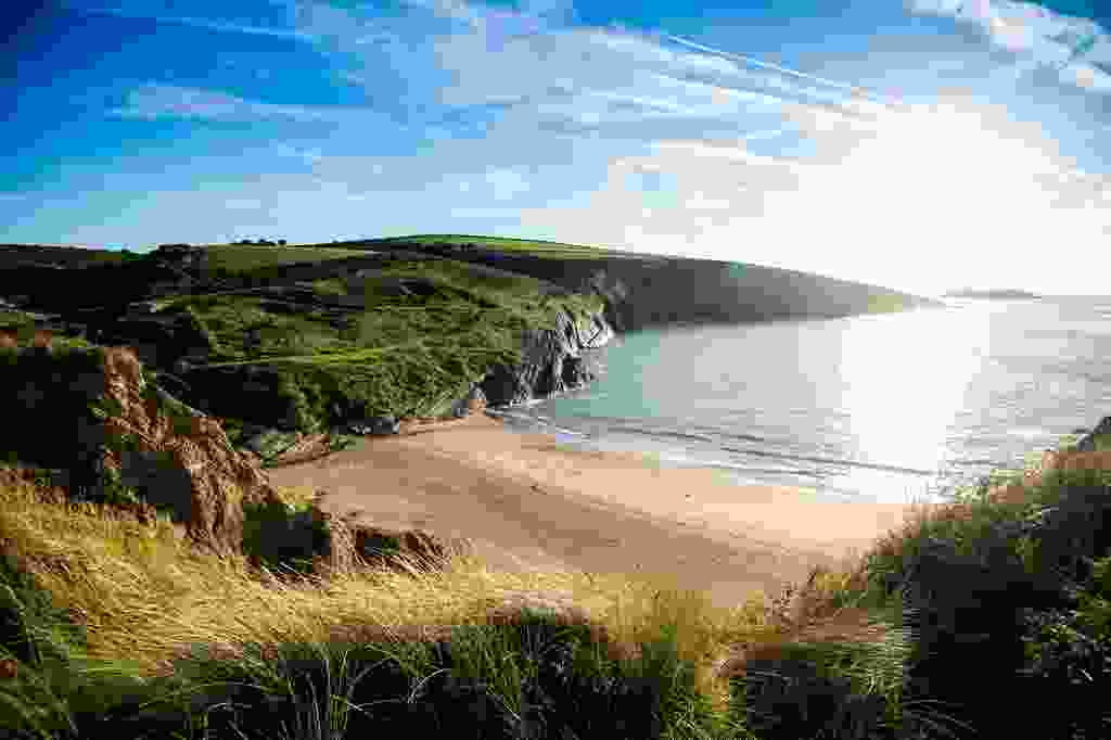 Spot dolphins from Mwnt's sandy, secluded bay (Crown Copyright 2021 Visit Wales)