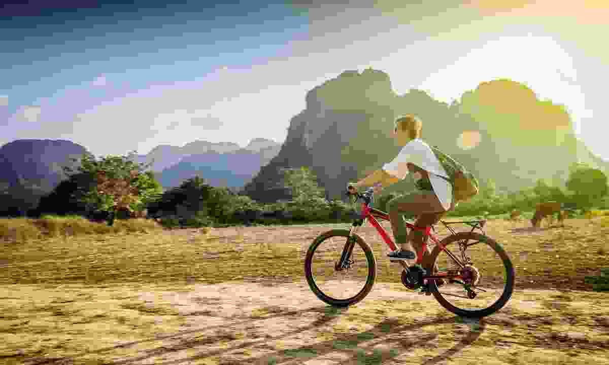 Cycling in Laos (Shutterstock)