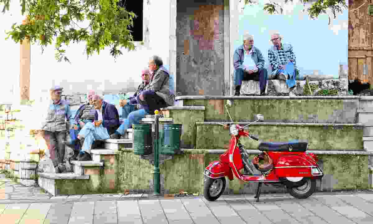 Greek street life on Corfu (Dreamstime)