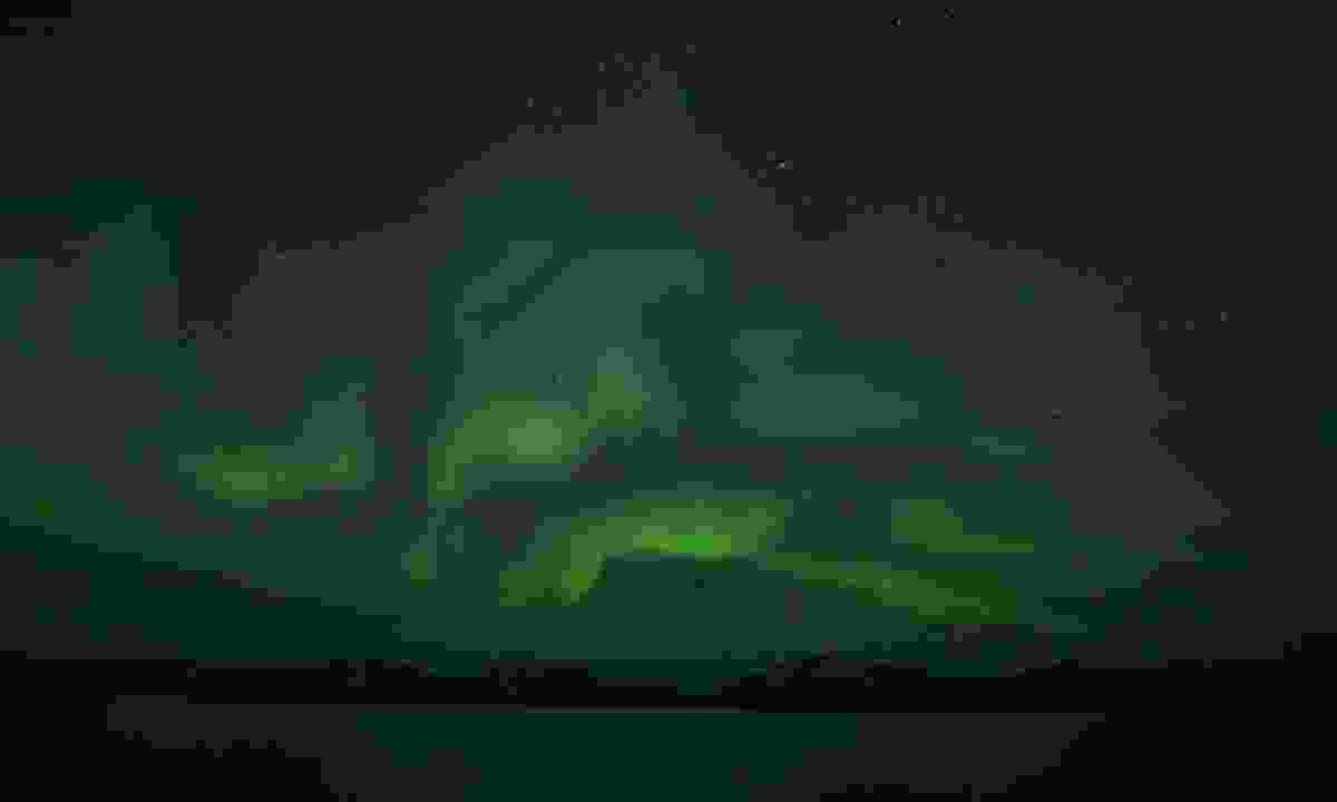 Aurora over mountains of Baffin Island  (Phoebe Smith)