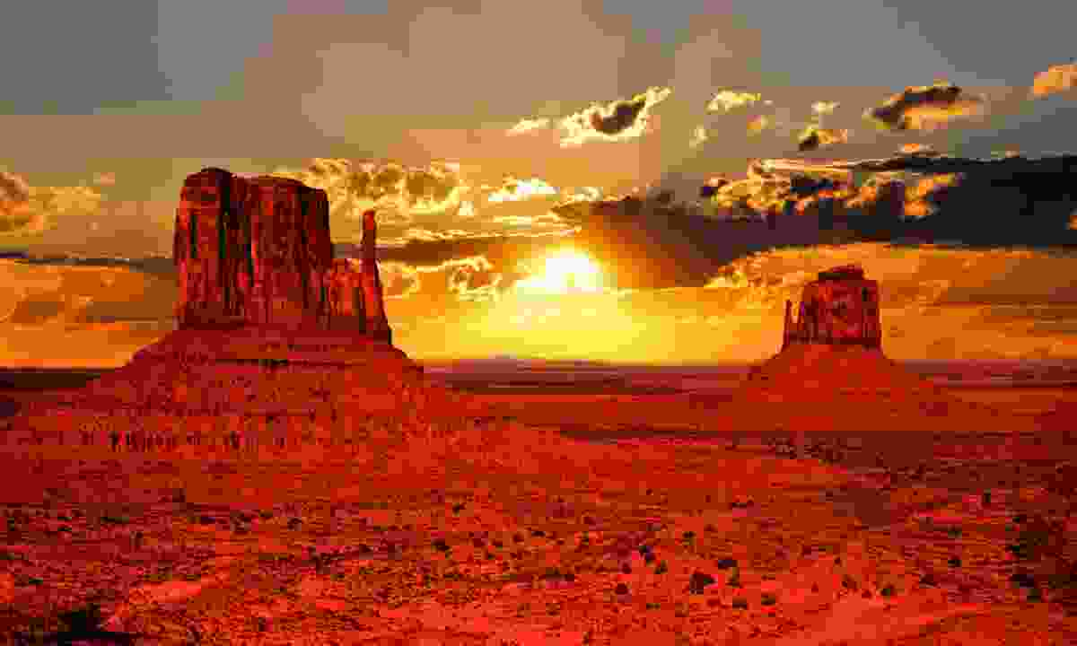 Sun setting over the rock formations of Monument Valley (Dreamstime)