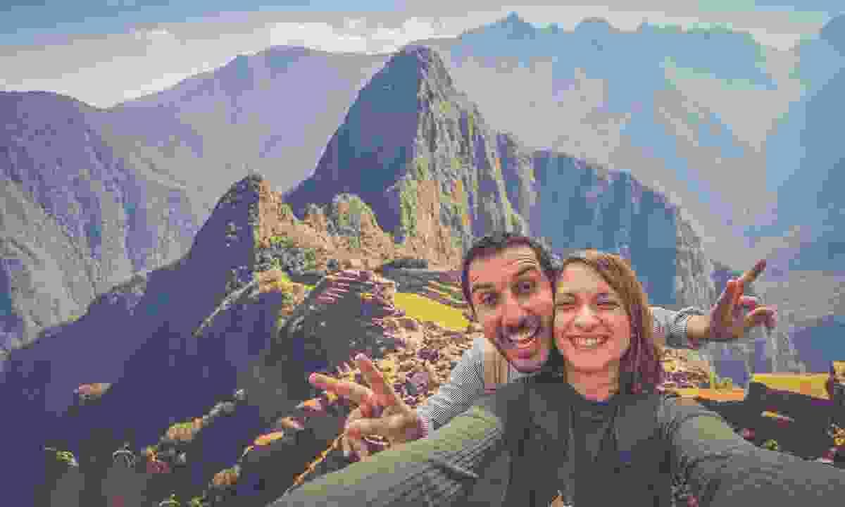 Taking a selfie at Machu Picchu (Shutterstock)