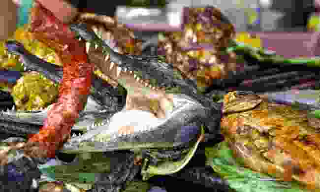 Crocodile head with sausage, Amazon market, Peru (Dreamstime)