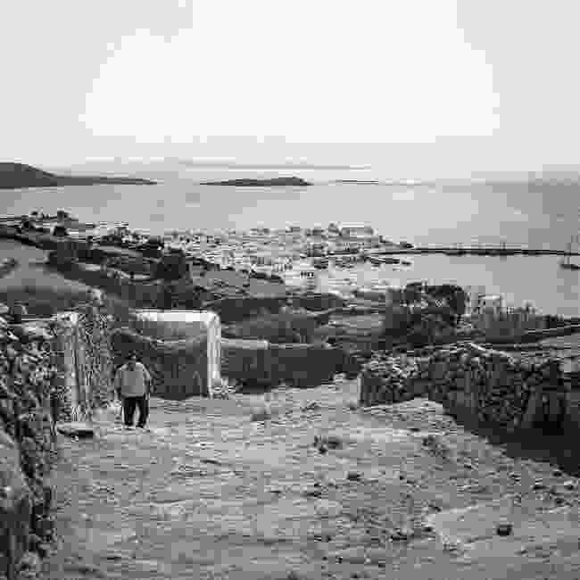 Panagiotis Koukas climbs to his home on the old pathway from Chora to Marathi (Robert A. McCabe)