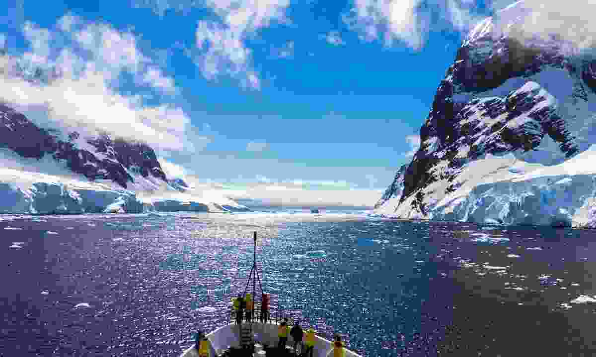 Cruising through the icebergs and mountains of Antarctica (Shutterstock)