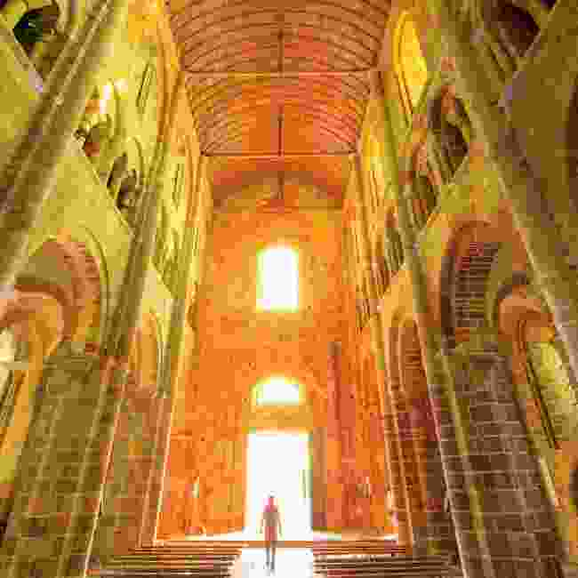 Exploring the abbey's cavernous interior (Shutterstock)