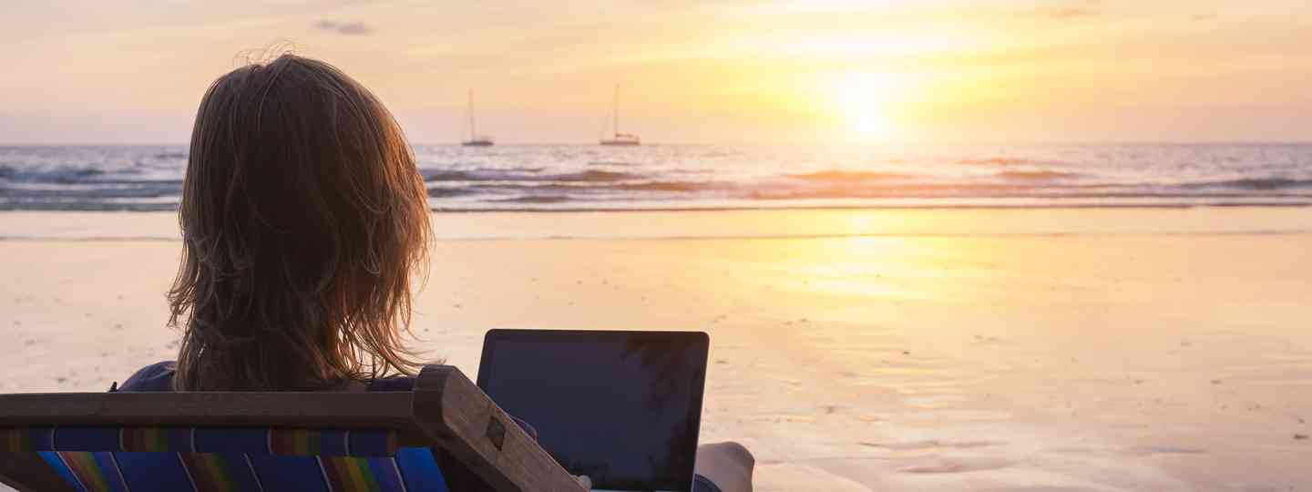 Travel writing on a beach (Shutterstock)
