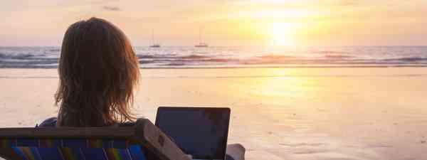 Travel writing on a beach (Shutterstock)