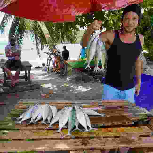 Fisherman selling his catch in the Seychelles (Peter Moore)