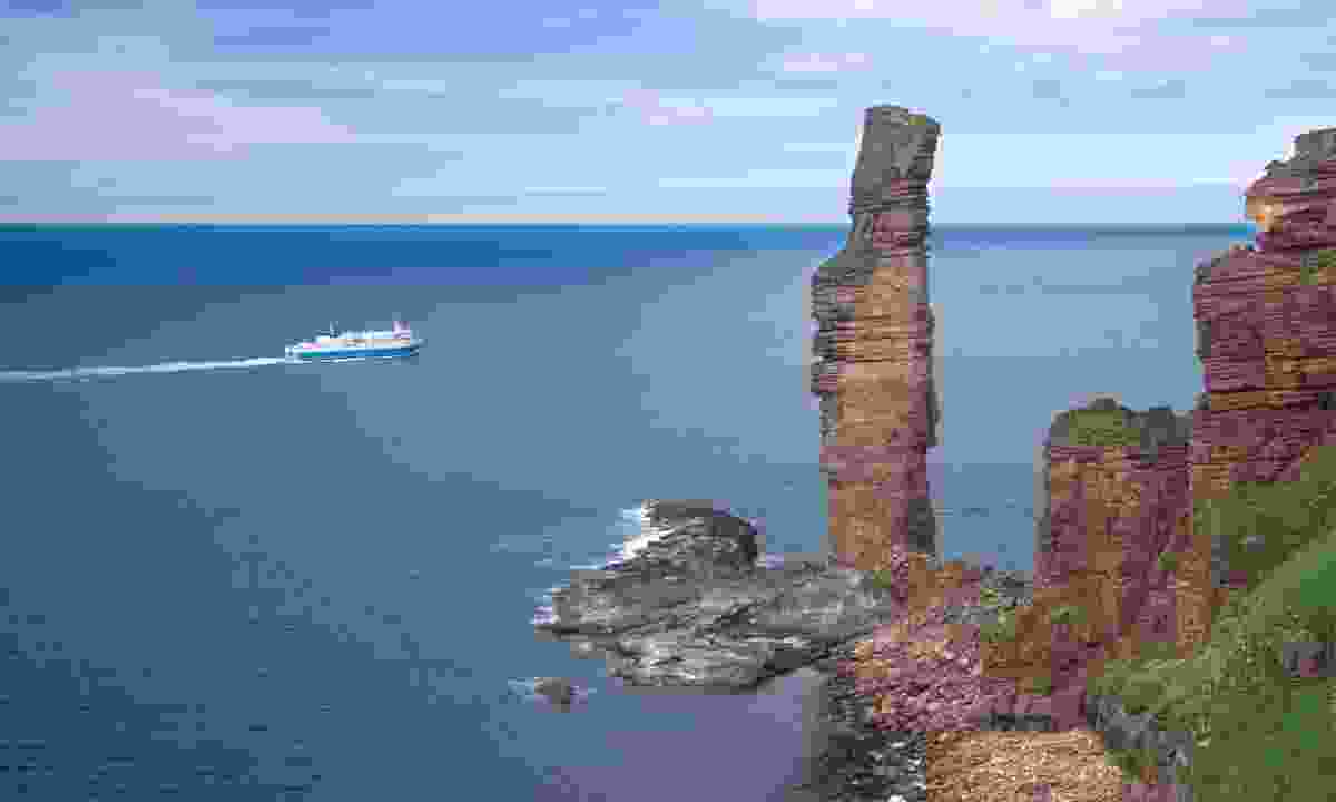 Old Man of Hoy and a ferry (Dreamstime)
