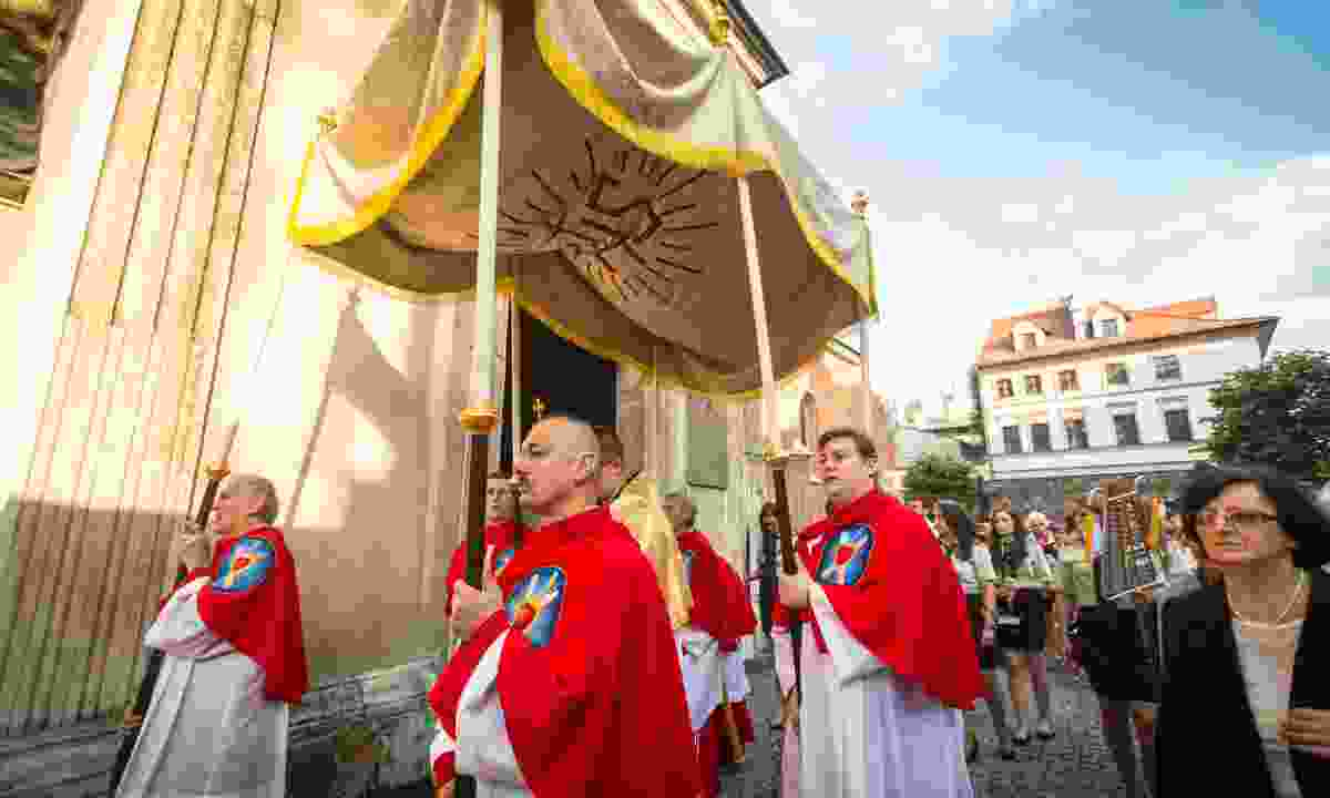 Priests leading the celebration of the Feast of Corpus Christi (Body of Christ) , also known as Corpus Domini, a Latin Rite celebrating belief in the body and blood of Jesus Christ. (Dreamstime)