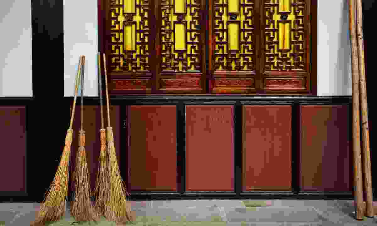 Straw brooms at temple in Chengdu (Dreamstime)