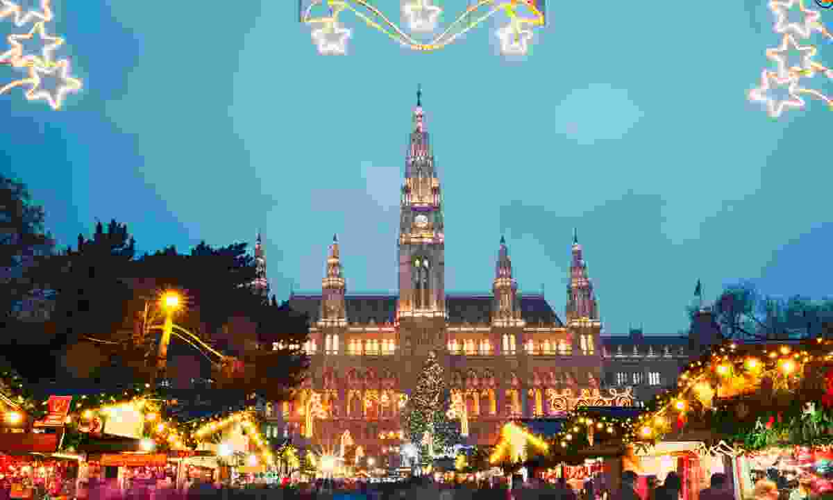 Christmas market in front of Rathaus city hall. (Dreamstime)