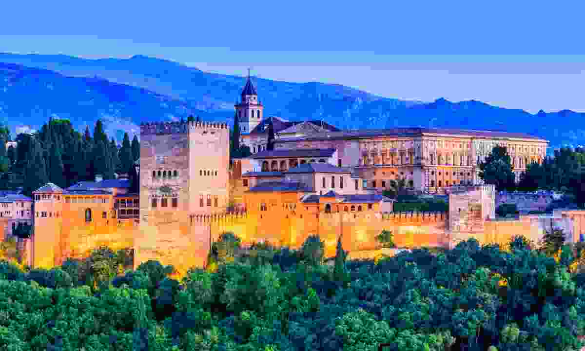 The Alhambra of Granada at twilight (Dreamstime)