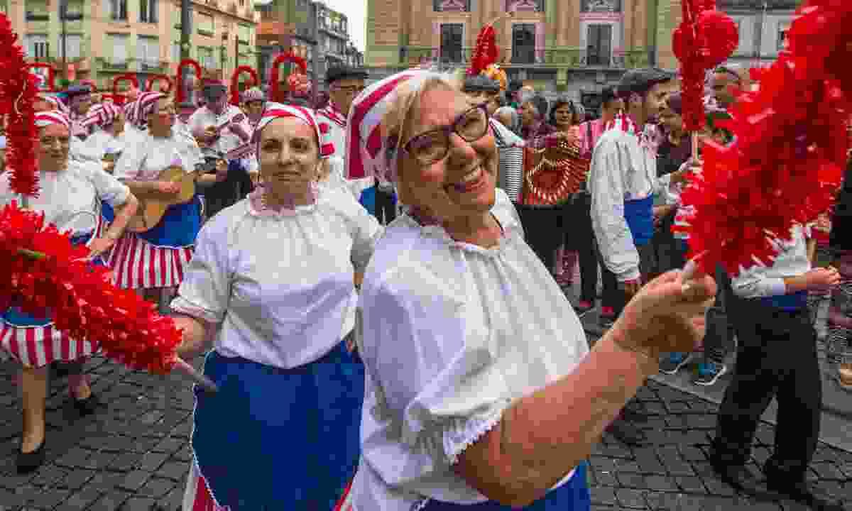 Celebrating at the Festival of St John in Porto, Portugal (Dreamstime)