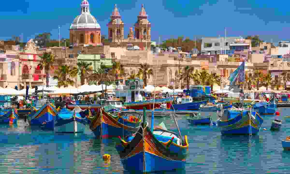 Traditional boats in fishing village of Marsaxlokk, Malta (Dreamstime)