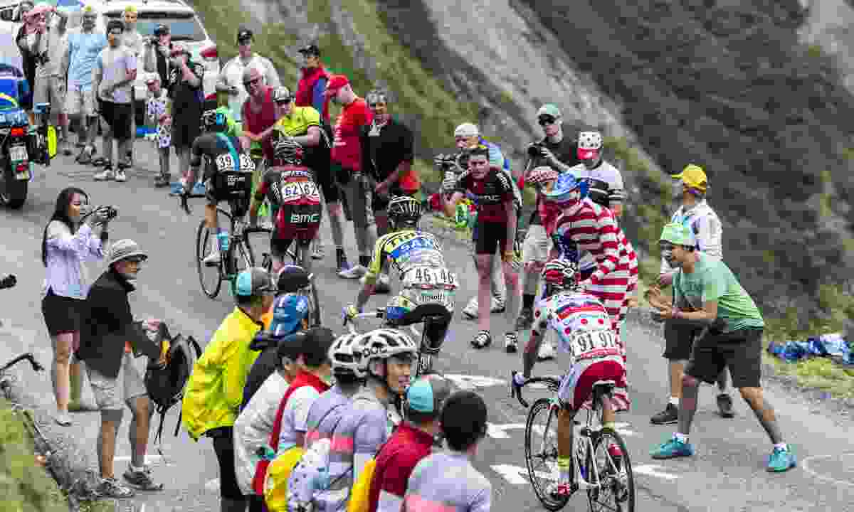 Fans getting close to cyclists at Col du Glandon during the Tour de France (Shutterstock)