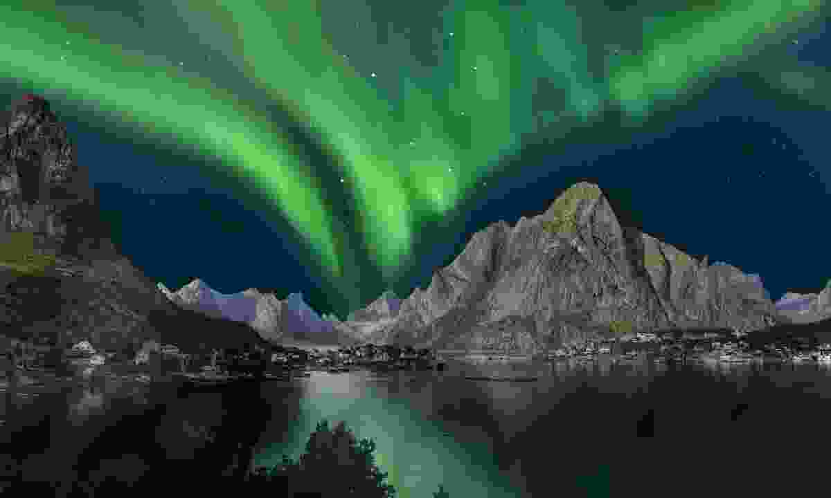 Northern lights reflected in the water in Norway (Dreamstime)