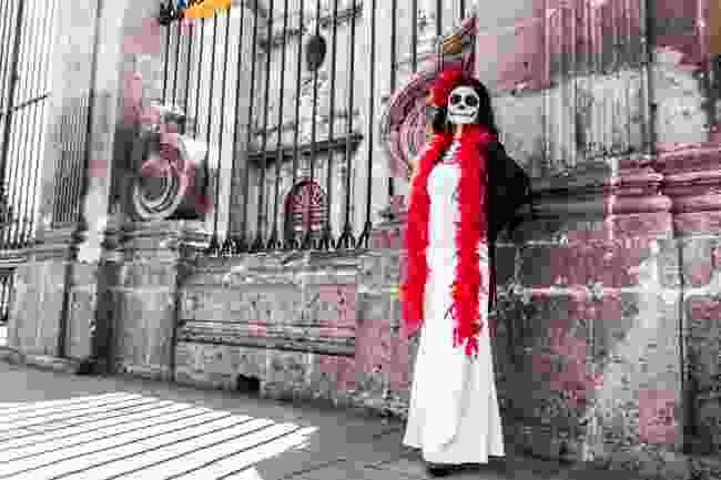 A woman dressed as Catrina, Morelia (Shutterstock)
