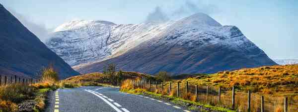 Cloudy sky and road to the snowy mountains in Connemara, County Galway, Ireland
