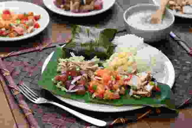 A traditional lunch of ahi poke, lomi lomi salmon, kalua pork and lau lau (Shutterstock)