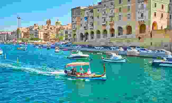 Dghajsa leaving the marina of Vittoriosa (Birgu) (Shutterstock)