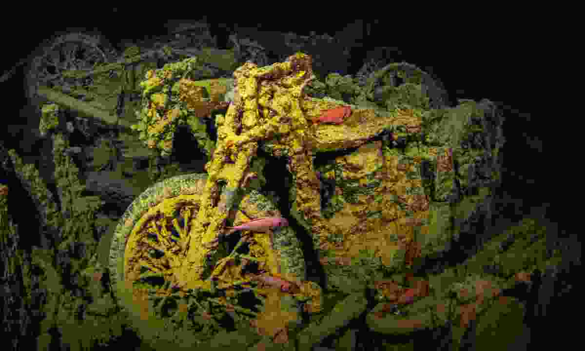 Coral encrusted motorcycle on the Thistlegorm (Shutterstock)