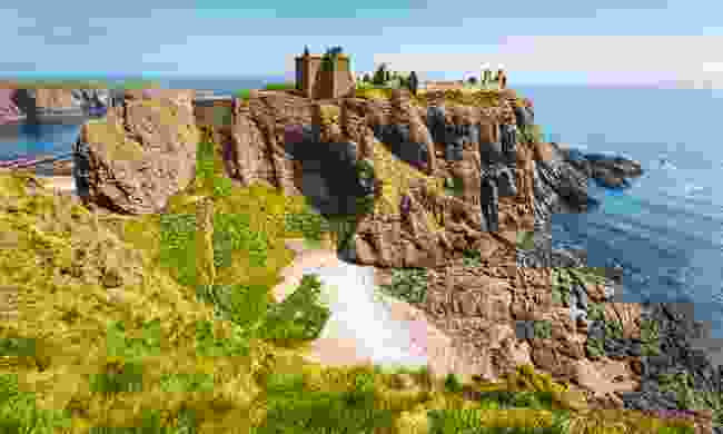 Dunnottar Castle perched above the sea (Shutterstock)