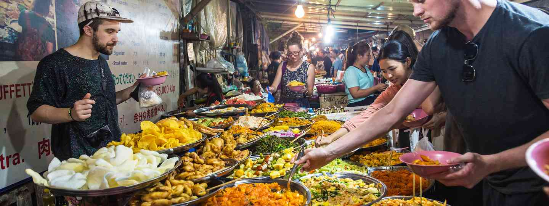 People enjoy vegetarian street food in Luang Prabang, Laos (Dreamstime)