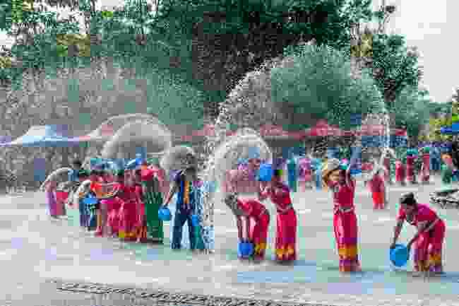 Water-splashing during the Songkran Festival in Thailand (Dreamstime)