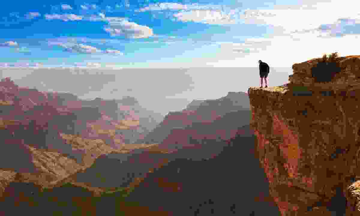 Man on the cliff in Grand Canyon (Dreamstime)