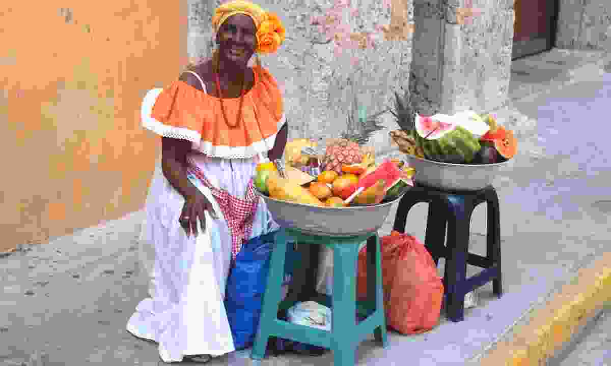 Friendly fruit seller in Cartagena