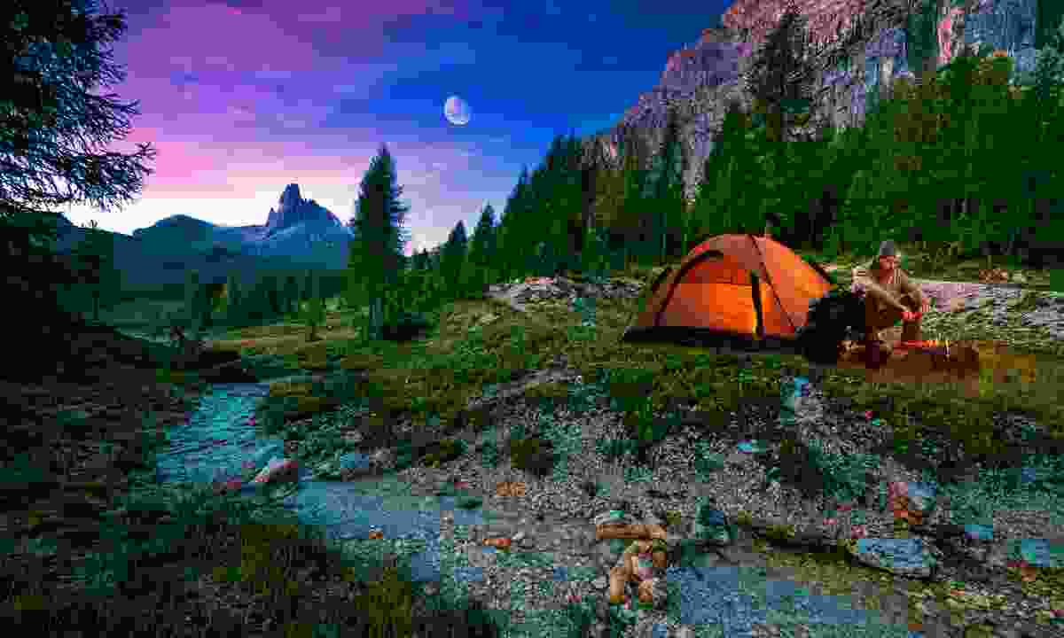 Man camping on a midsummer night (Dreamstime)