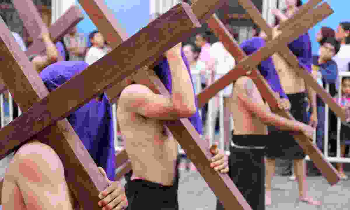 The Procession of Silence in Oxaca, Mexico. Starting at sunset on Good Friday, penitents re-enact the trial, crucifixion, death and burial of Jesus (Dreamstime)