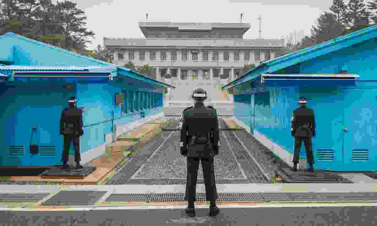 South Korean soldiers stand guard at the DMZ in Panmunjom (Shutterstock)