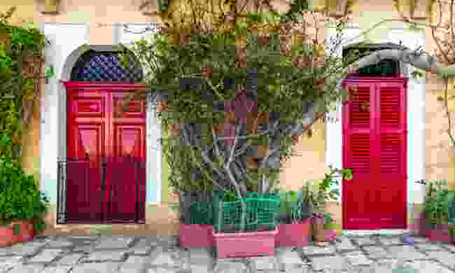 Traditional red doors and houses on the streets of Senglea (Shutterstock)