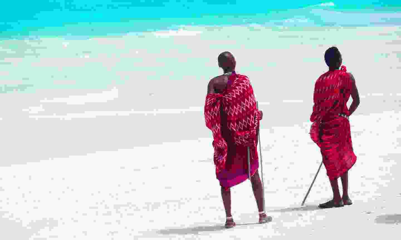 Masaai by the beach in Zanzibar (Shutterstock)