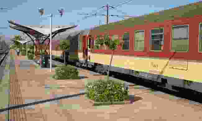 Marrakech Express pulled into a station (Dreamstime)