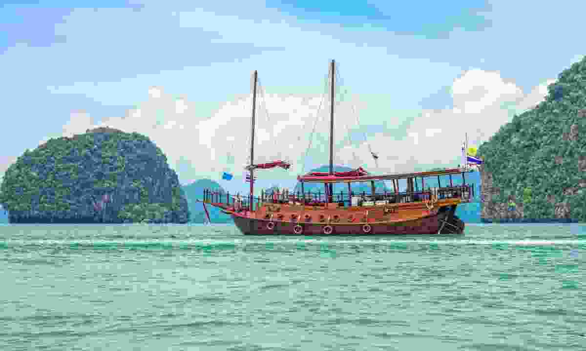 Sail on a junk boat in Thailand (Dreamstime)