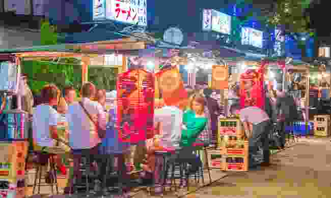 Fukuoka's world famous food stalls (yatai) located along the river on Nakasu Island. (Dreamstime)